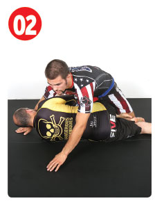 Once he's in half-guard Garry puts weight on his opponent's leg by sitting back. If he allows his opponent to get flat on his back it makes things much more difficult.