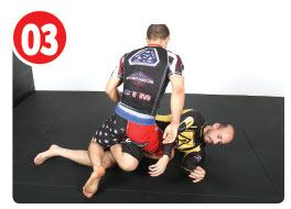 At this point Garry can lock up a figure four with his own legs, this is great if he can get it, but what's more important is keeping weight on his opponent and starting the roll as quickly as he can.