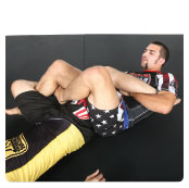 B. Garry pivots to the side of the target leg, while threading his left leg through his opponent's legs creating a figure 4.