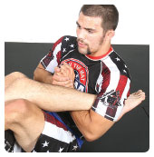 A. Garry picks the right ankle to attack and gets an overhook with his left arm holding it tight between his arm and body up near the armpit.