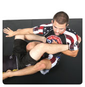B. He then pushes the left leg away and brings his right knee up between his opponent's legs to isolate the target leg.