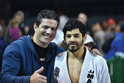 Jean Jacques Machado with a student.